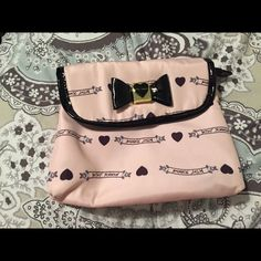 Betsey Johnson makeup bag Rarely used, no marks inside or out. Betsey Johnson Bags Cosmetic Bags & Cases