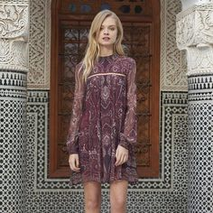 The Jetset Diaries' fall-hued paisley printed mini dress features a metal chain trim along the front with sheer sleeves and a sexy exposed back. You'll be a stunner in the Labyrinth Paisley Mini Dress!