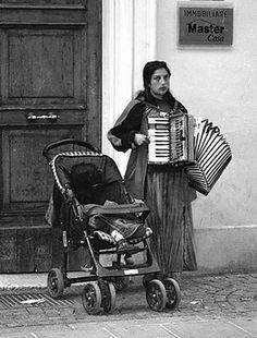 A Romani young woman with an accordion. Italia, Ferrara. 2003