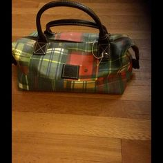 Authentic Dooney and Bourke Plaid hand bag This bag is brand new. The bag is a variety of beautiful colors and adds a bit of pop to any outfit. Dooney & Bourke Bags Totes