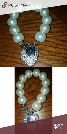 Chico's Chunky Pearl Bracelet w Rhinestone Heart Also has a silver stamped Chico's charm..... Big pearls.... Super cute! Silver rhinestone pave heart and it's STRETCH..... Will come in a generic white box...Feel free to ask any questions....  ✅Make an offer through OFFER button ONLY ✅Negotiations welcome ❌No trades  ❌No PayPal ✴Bundles encouraged✴ Chico's Jewelry Bracelets