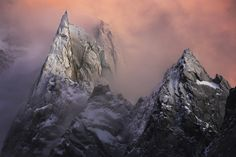 L'aiguille des Deux Aigles - The gentle cold winter light after sunset .. On this very sharp and elegant peak from the french Alps. Photography by Alexandre Deschaumes