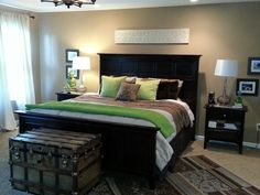 I added green pillows and throw from Home Goods. Tan brown green bedroom.