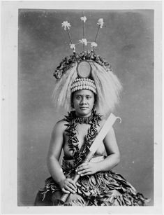 Samoan female ceremonial dancer, taken by Thomas Andrew during the 1890s. The costume worn by this woman are only worn by women who are called Taupou (queen) or a female from a particular family whose role it is to dance at a ceremony. Not everone wears the headpiece which is called a tuiga.