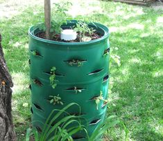A simple garden tower DIY, placed on rollers so you can move it inside when frost hits. Where do you buy one of these big containers?