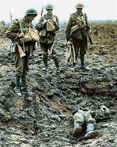 WW1 – British soldiers over the body of a German soldier.