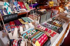 Office supply baskets to organize stuff on the tables! {Artist Market Booth detail by jesse.mazer, via Flickr}