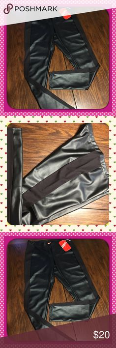 Black Leggings Looks like leather but is non leather material with a black material going down both sides---- if I could only get in these they would not be on here. Stretchy and comfortable. In seam is 31 in and waist is like 32 but has a great deal of stretch. LOVE THESE Kirna Zabete Pants