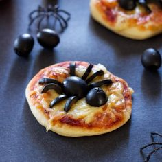 Spooky Mini Spider Pizzas are the perfect appetizer or dinner to make on Halloween!