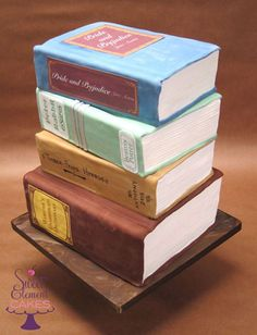 Stack of Books Birthday Cake by sweetelement. I'd use Divergent, The mortal instruments, maximum ride, TFIOS