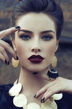 Bold lips and dark nails