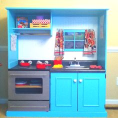 Old entertainment center turned play kitchen.   I LOVE the how this play kitchen is so open.  Love the window and oven.  Wish there was a tutorial, but the link is just a jpeg.  No idea where this kitchen is from.  Can not find the source anywhere.