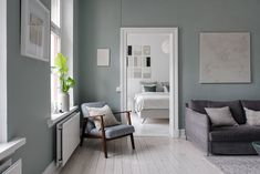 The green-grey color of the living room wall in this apartment is such an eye-catcher. I like that the same color comes back in the pillows in the bedroom as well. The kitchen has a very simple design, yet the … Continue reading → Nordic Bedroom, Nordic Design, New Living Room, Scandinavian Interior, Home Staging, Wall Colors, Color Inspiration, Simple Designs, Green And Grey