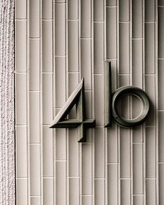 House number - Residence in Zurich by Atelier Abraha Achermann Signage Design, Lettering Design, Branding Design, Identity Branding, Visual Identity, Environmental Graphic Design, Environmental Graphics, Office Signage, Wayfinding Signs