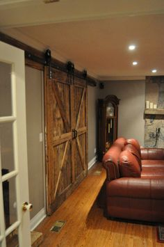 Double Custom Bi-Part Barn Doors created for this livingroom. Makes quite the entrance!
