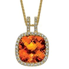 This yellow gold orange citrine and diamond necklace is the perfect addition to a orange inspired wedding.
