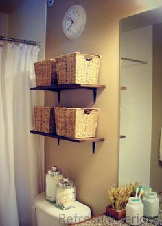 Above toilet.. Neatness. His shelf. Her shelf. Good idea.