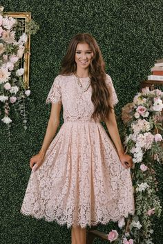 We finally found the dress of our dreams! This short sleeve blush midi dress is flattering, romantic, and just plain...