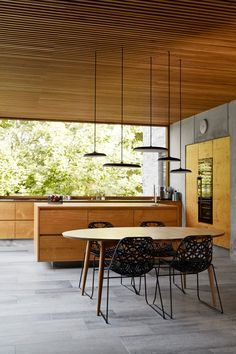 Not only did Rand design the building, he also designed most of the furnishings, which were custom made in oak by a local cabinet maker. Kitchen Interior, Kitchen Decor, Self Build Houses, Spiral Staircase, Cabinet Makers, Modern Kitchen Design, Interior Inspiration, Interior Architecture, Building A House
