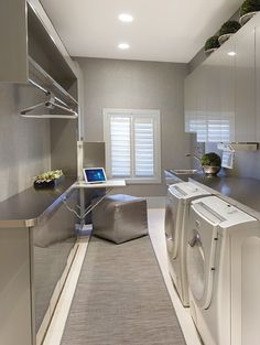 This is a pretty hot looking laundry room. I would totally bling out this room with a crystal chandelier, a huge glitzed out mirror, and if there's enough room, a hollywood regent style chaise lounge. Maybe after all that I would finally enjoy doing laundry.