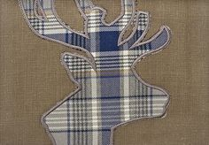 Mont Dolent Curtain Fabric Brown linen mix curtain fabric with appliqued stags head in blue and grey tartan. Suitable for soft furnishings and curtains.