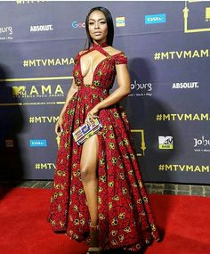 This dress! Is! Perfection! South African actress Nomzamo Mbatha slaying in this high split dress in wax cloth. Love the criss cross neckline #ankara #