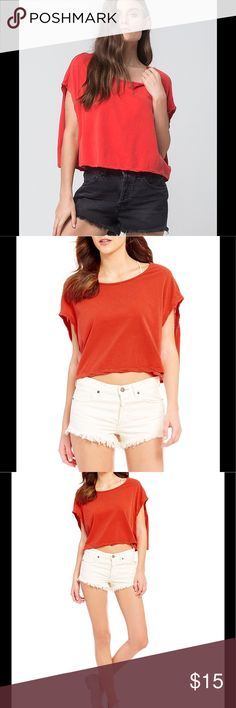 Free People Scoop-Neck Top Free People scoop-neck top features the cute boyfriend relaxed style. Top is loose fitting, with wide arm holes and crop top design. Top is fierce red, wild and free. Free People Tops Crop Tops