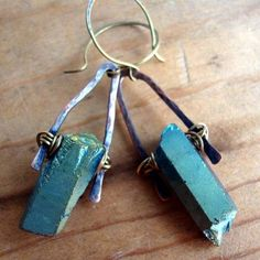 """Handforged copper, brass and gorgeous quartz points that have been treated with a irridescent finish.  Each pair starts out as simple wire until Barbara cuts, anneals, and hammer each piece.  Beautiful, rustic and bohemian  The specifics:  size:2.25"""" from the top of the ear wire.  status..."""