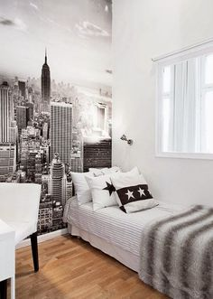 Monochrome bedroom with skyline wall mural for a girl who loves the city.