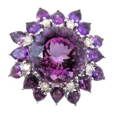 Intense Purple Amethyst Diamond Gold Ring | From a unique collection of vintage more rings at https://www.1stdibs.com/jewelry/rings/more-rings/