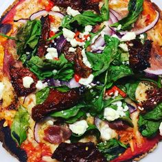 I love pizza but hate the thick dough you get with most pizza places, plus the cost of pizza's nowadays are ridiculously expensive! So, I love to make my own with a tortilla wrap and whatever topping I choose. This one has sun-dried tomatoes, spinach, red onion and feta