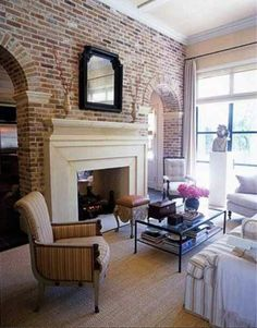 Brick wall two way fireplace, would be good idea for keeping room off kitchen-master BR section