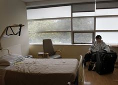 Tim Martin sits alone in his new spacious room at Laguna Honda hospital in 2013. Tim Martin, a man who is blind, deaf and unable to speak, arrived in San Francisco from Reno. Photo: Brant Ward, The Chronicle