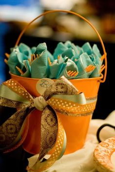 For Your Next Holiday Party Or Baby Shower...wrap utensils in colorful napkins & place in a cute bucket.  This blog has many ideas for a Lil' Pumpkin Baby Shower.
