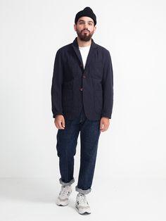 Three button peak lapel patch pocket blazer