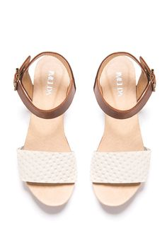 Handmade clog sandals in neutral shades are ready to step into summer days.