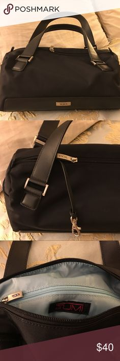 """Tumi mini canvas satchel with leather handle Absolutely adorable Tumi satchel with leather trim and handle. Brand new, it has been hidden in my closet. Expensively weighty silver key ring, zipper accessories. Bright blue interior with 2 side pockets. 7""""h x 14""""l x 6""""w Tumi Bags Satchels"""