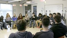 Summit students sit in a circle for a whole-class discussion.
