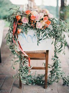 Floral decorated wedding chair: http://www.stylemepretty.com/destination-weddings/2014/11/25/italian-farm-wedding-inspiration/   Photography: 2 Brides - http://2brides.se/