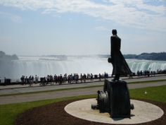Nikola Tesla's statue at Niagara Falls, Canada.  Tesla Monument at Niagara Falls unveiled on July 9, 2006. Tesla is standing atop an AC motor, one of the 700 inventions he patented. In the background is Niagara Falls, Canadian side.