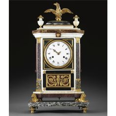 An Italian neo-classical gilt-bronze-mounted white marble, porphyry and granite mantel clock, Workshop of Luigi and Giuseppe Valadier, Roman, circa 1780/1790.