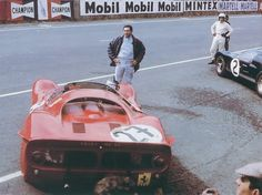 Waiting for the start. Le Mans 1966.Pedro Rodriguez ( NART Ferrari P3) and the winner (with Chris Amon) Bruce McLaren ( Ford GT40 MkII).