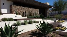 HGTV: Sage Design Studios integrated terraces and drought-conserving plants into the front and back yard designs to help this Southwestern home conserve water.