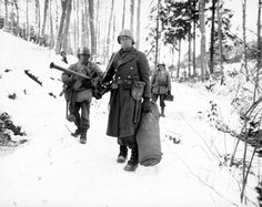 After holding a woodland position all night near Wiltz, Luxembourg, against German counter attack, three exhausted men of B Company, 101st Engineers, emerge for a rest. Jan 1945 Military Photos, Military History, Luxembourg, Army Medic, Sneak Attack, Ww2 Photos, Ww2 Pictures, Art Of Manliness, History Online