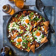 Oven-baked chilaquiles with eggs and feta