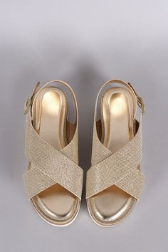 7e22643c5b5600 Description A glittery flat sandal featuring wide crossed straps