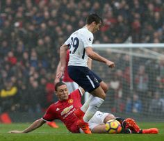 Nemanja Matic of Manchester United in action with Harry Winks of Tottenham Hotspur during the Premier League match between Manchester United and...