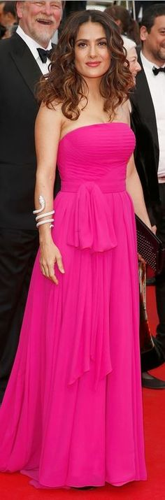 Who made  Salma Hayek's pink strapless gown and black studded clutch handbag that she wore in Cannes on May 17, 2014?