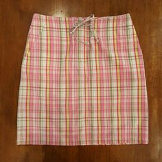 """Madras plaid cotton skirt Madras plaid in hues of pink, yellow and sage green. 100% cotton. Back flap pocket. Two front side seam pockets. Zipper fly with button and drawstring waist. Waist 28"""" Length 19"""" The Limited Skirts"""