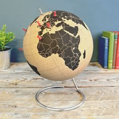 Cork Globe / Sharing your globetrotting experiences is now possible from the Cork Globe on the table which comes with additional push pins for attachment. http://thegadgetflow.com/portfolio/cork-globe/